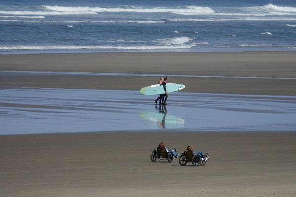 Beyond surfing, visitors can rent bikes to ride along the sands of Cannon Brach in town.