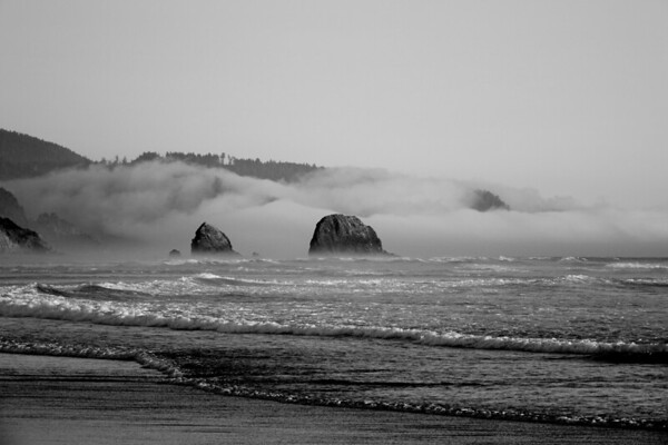 A black and white rendering of a foggy morning in Cannon Beach