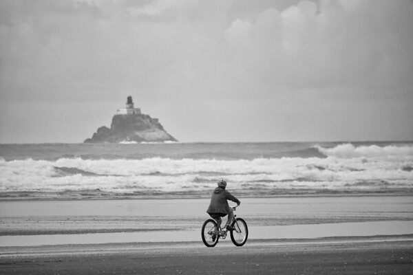 Riding a bike by the Lighthouse on Cannon Beach