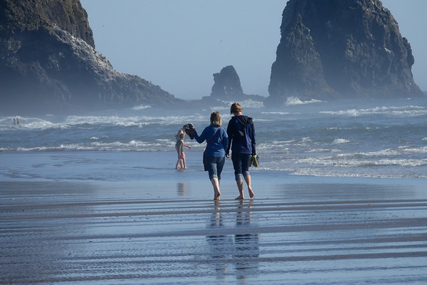 Walking in the low tide by the Haystack Rock in Cannon Beach.