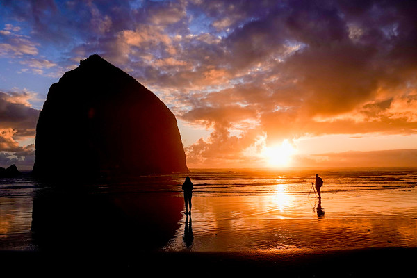 Sunset in Cannon Beach. Photo geek note: this is an HDR photo, three photos merged into one, a combination of under-exposed, over-exposed and one normal exposure