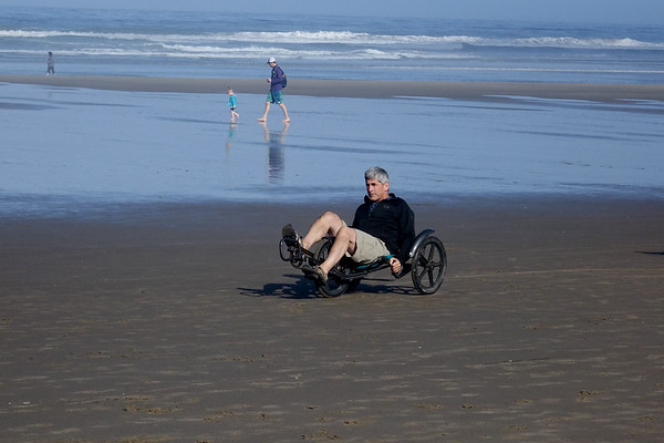 Riding along the sands of Cannon Beach in a mini bike
