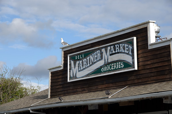 A seagull rests atop the Mariner Market, the main food store in Cannon Beach