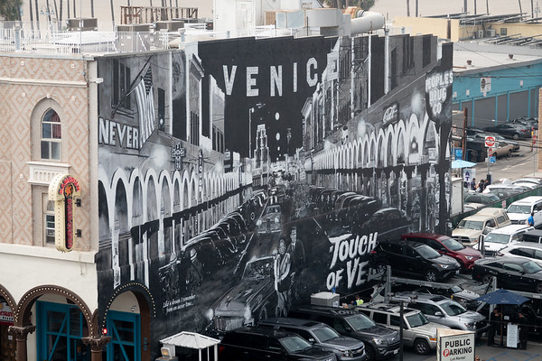 A mural of Windward Avenue and the Venice sign welcomes visitors at a local parking lot.