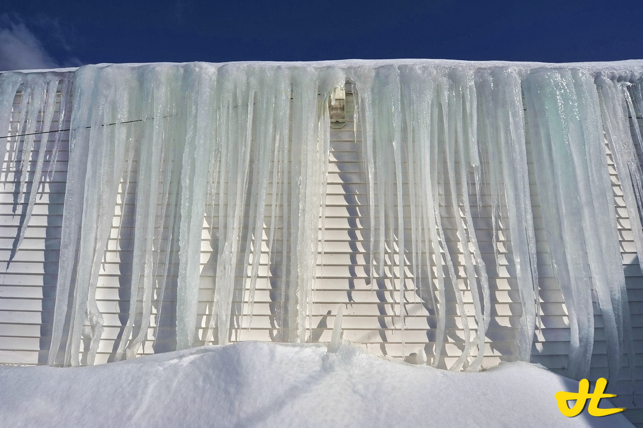 Caught this one just in time at Moulton's Market, as they removed it the next day. These icicles are easily 10 feet tall and starting to curve at the bottom...