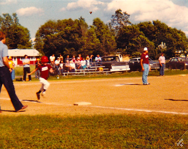 Jeff beats out bunt.  (Hey, where the first baseman)