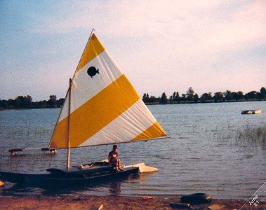 Jeff doing one of his favorite things.   Sailing on Honey Lake