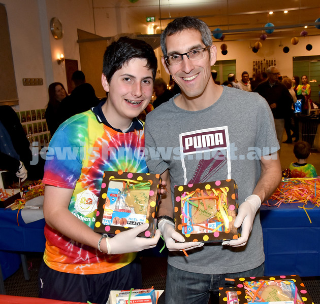 JEMS honouring volunteers. From left: Rafi and Eitan Franklin. Pic Noel Kessel