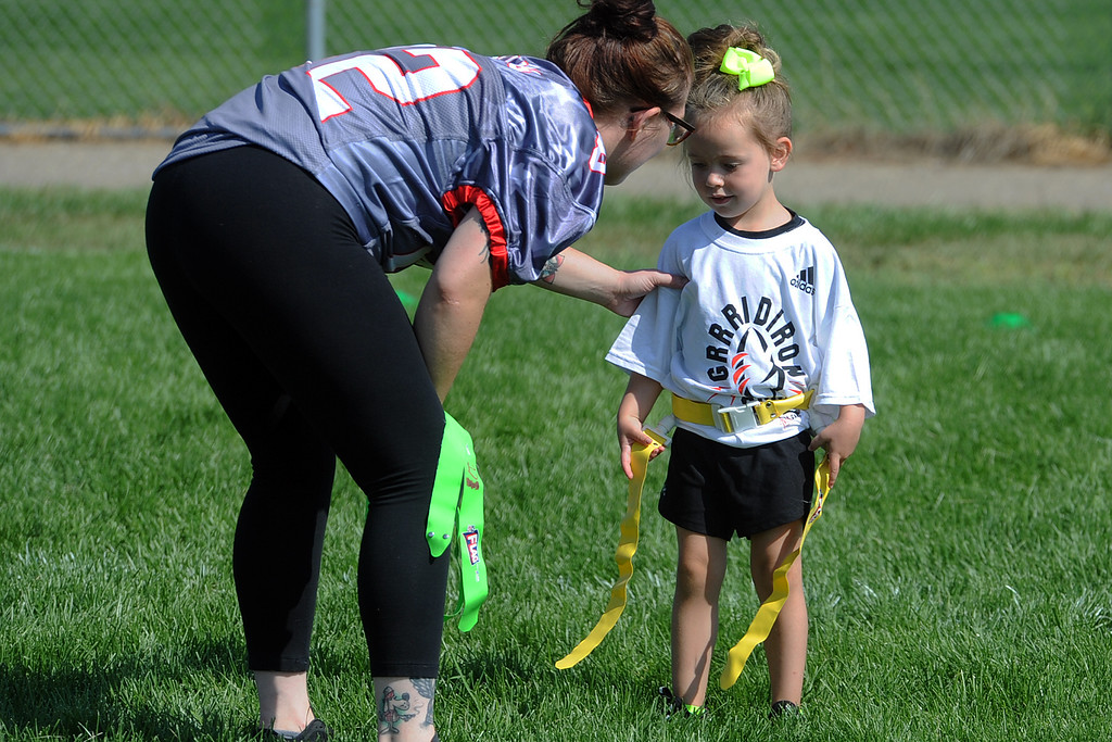 . A member of the Mile High Blaze gives instruction to a young participant during Jen Welter�s Gridiron Girls Flag Football Camp on Sunday, August 12, 2018 at Mountain View High School in Loveland, Colorado. (Sean Star/Loveland Reporter-Herald)