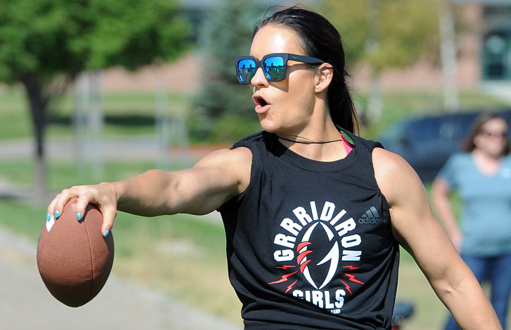 . Jen Welter gives instruction during her Gridiron Girls Flag Football Camp on Sunday, August 12, 2018 at Mountain View High School in Loveland, Colorado. (Sean Star/Loveland Reporter-Herald)
