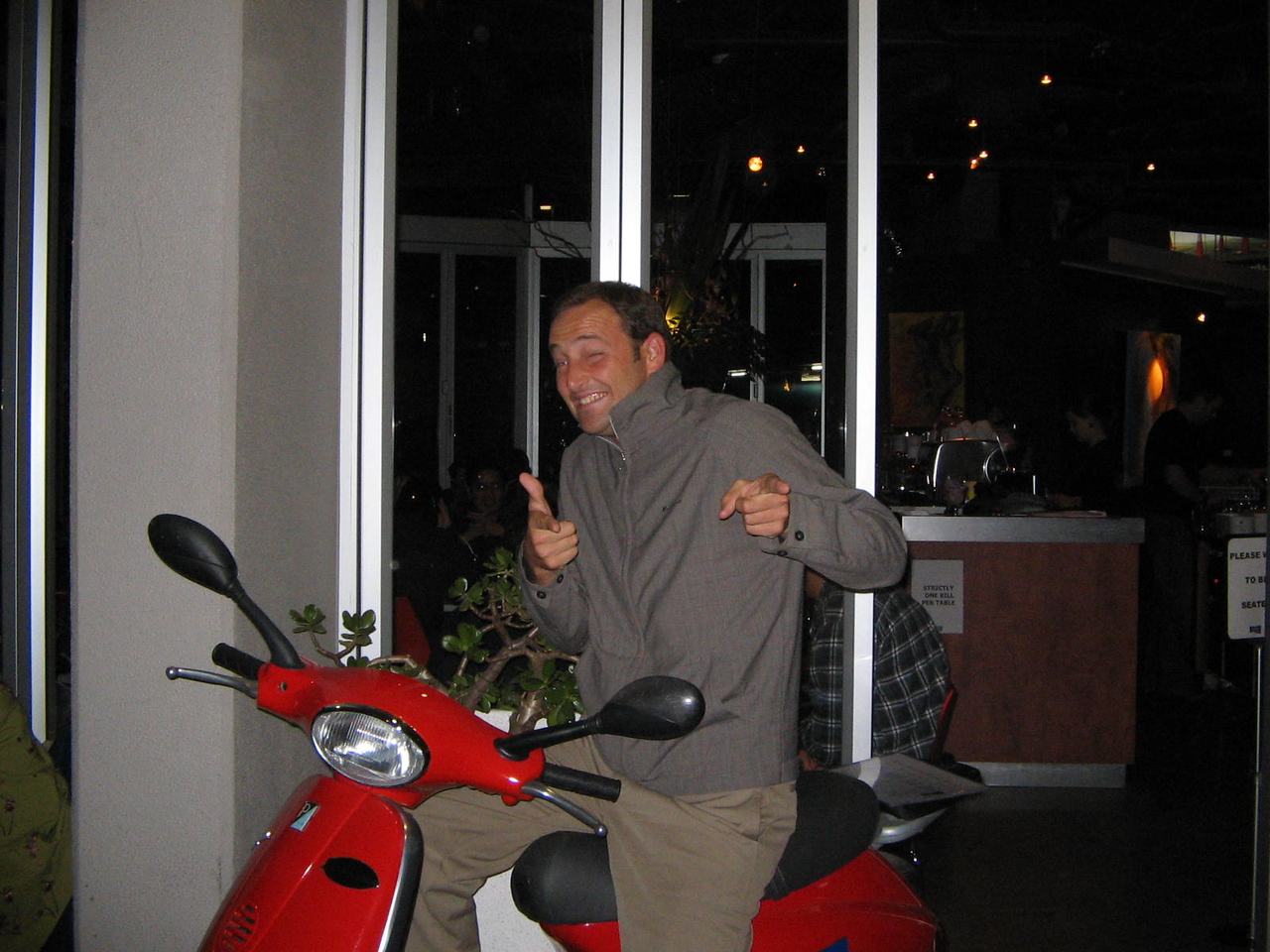 "ciao.                                                             <br /> (quentin is wearing his ciao jacket;  which has an even longer story attached to it but suffice to say that when he wears said jacket, he feels inclined to often say ""ciao"" - and all agree that the jacket does warrant the comment... the moped siting outside the bar is another story altogether.)"