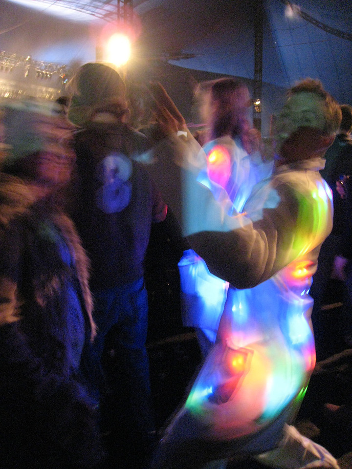 and a guy in a light up suit at devo