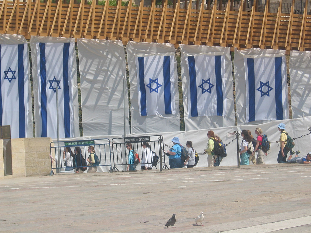Israeli flags by the wall