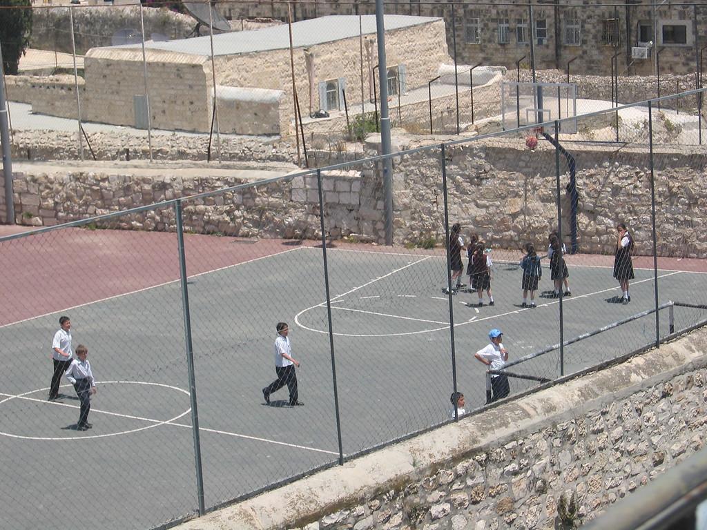 Muslim kids playing basketball outside