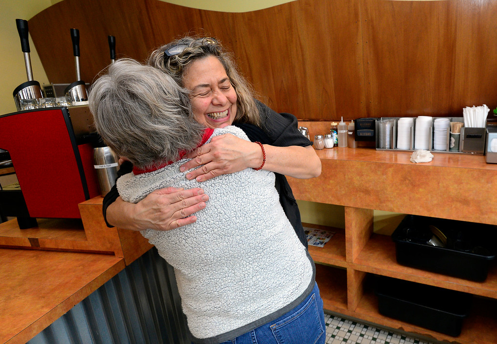 . BOULDER, CO FEBRUARY 14, 2019 Jenny Blanchard gets a hug from customer Kathy Madsen at Vic\'s Espresso and Coffee on Main Street in Louisville on Thursday morning. It was Blanchard\'s last day at the coffee shop. For more photos go to dailycamera.com  (Photo by Paul Aiken/Staff Photographer)