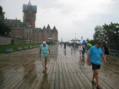 Boardwalk by Hotel Frontenac high above and overlooking the St Lawrence river, in a light rain.