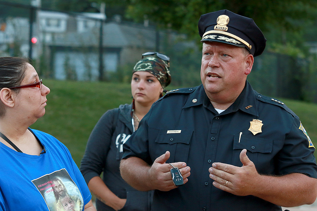 . A rally for Jeremiah Oliver and  child abuse was held at Riverside Park on Friday night, August 11, 2017 in Fitchburg. Fitchburg Police Chief Ernest Martineau talks to the family and friends at the rally. SENTINEL & ENTERPRISE/JOHN LOVE