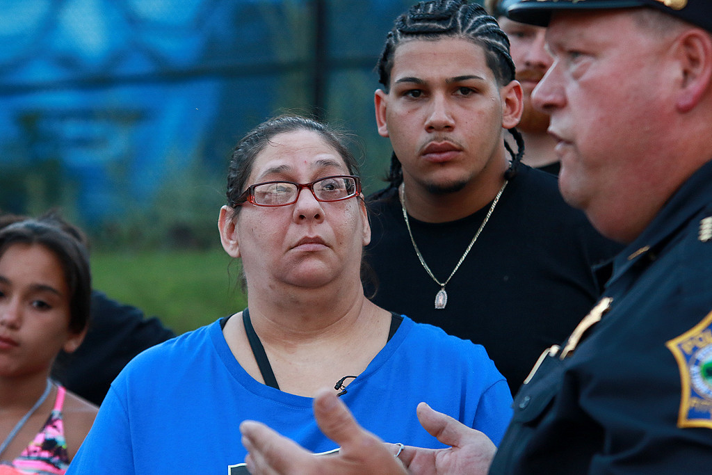 . A rally for Jeremiah Oliver and  child abuse was held at Riverside Park on Friday night, August 11, 2017 in Fitchburg. Rose Valcourt Jeremiah\'s aut and Sandro Oliver, 23, his cousin listen to Fitchburg Police Chief Ernst Martineau as he address the family and friends at the rally.  SENTINEL & ENTERPRISE/JOHN LOVE
