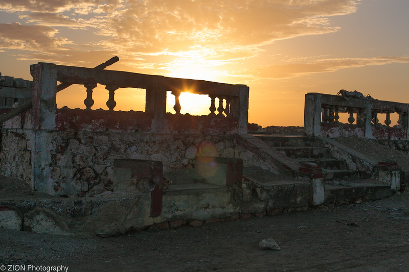 Sunrise through old battle ruins at the point in Jeremie, Haiti