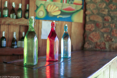 Three colorful water bottles