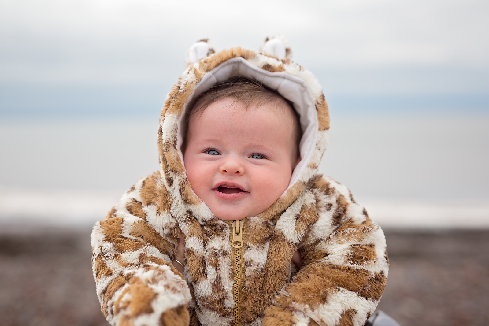 too cute - baby photograph in cheetah snowsuit