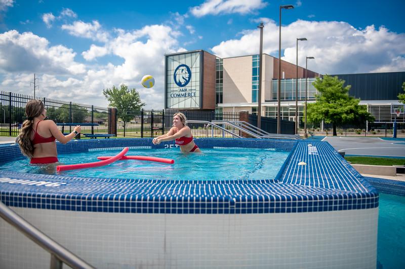 M21086- Campus Rec Pool, Lifeguards playing-1054