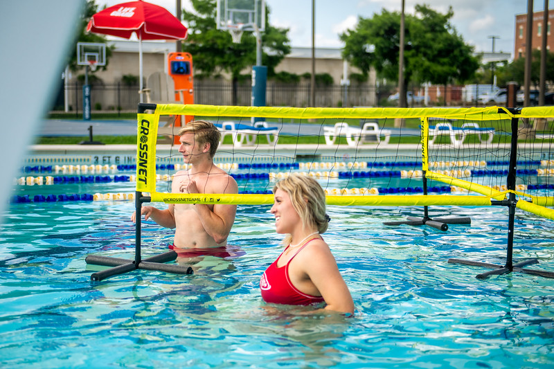 M21086- Campus Rec Pool, Lifeguards playing-1114