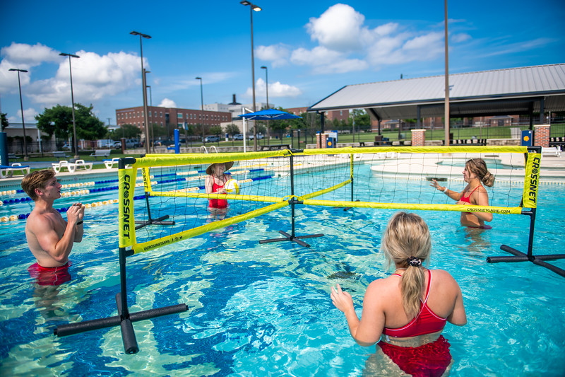 M21086- Campus Rec Pool, Lifeguards playing-1139