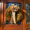 A wreath of fresh magnolias awaits visitors at the front door.