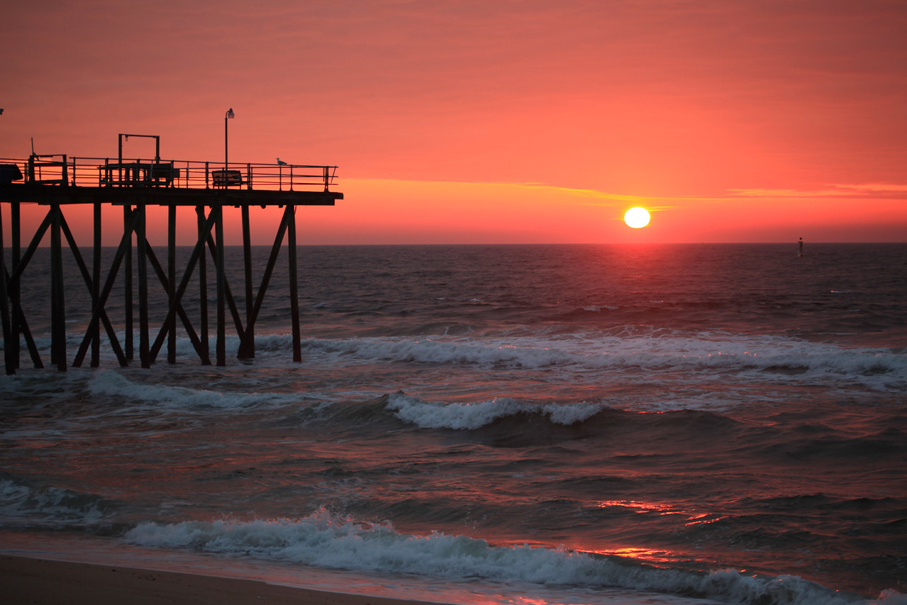 "Rare pink orange sunrise over the jersey Shore, That is the Belmar Fishing Club dates back to 1909.  Rare pink orange sunrise does not happen that often , you need water vapor in the air to create this color but not too much otherwise its just foggy<br /> Prints of this (and all my images) are for sale, to purchase a print of this photograph, click ""Buy"" on the upper right or the shopping cart above and choose your size and quantity. <br /> <br /> Note: Your prints will not have any watermarks (writing) on them. It will be just the photograph. In all of its OMG glory."