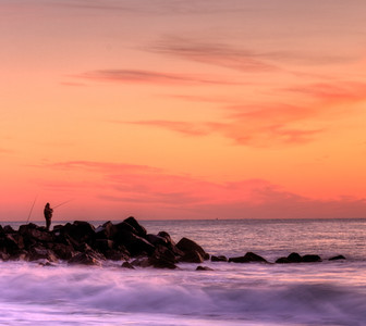 Fisherman on the rocks Jersey Shore print photo