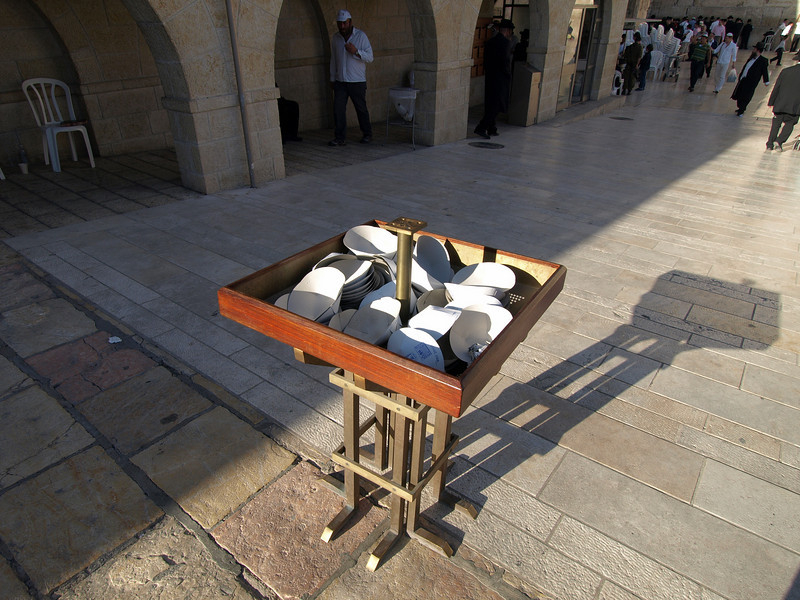 Men must cover their heads to enter the plaza; these carboard kippas are for tourists.