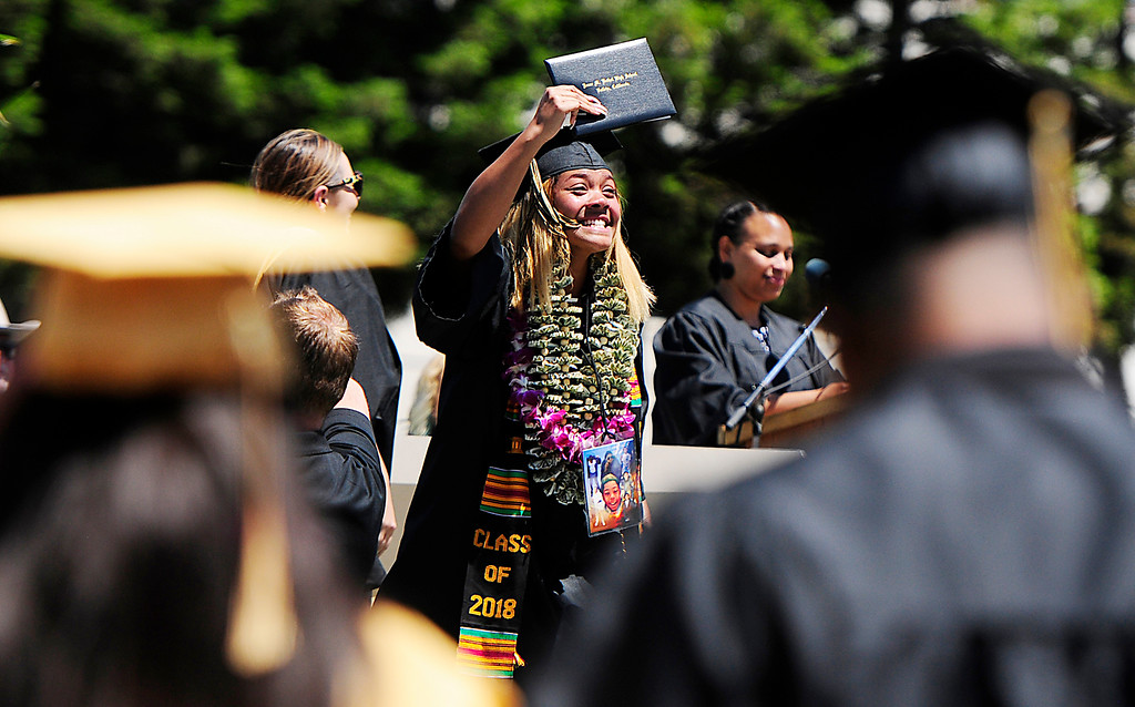 . VALLEJO, CA - JUNE 8, Shawnte Gills smiles as she shows off her diploma during the Jesse Bethel High School graduation on Friday. (CHRIS RILEY/TIMES-HERALD)