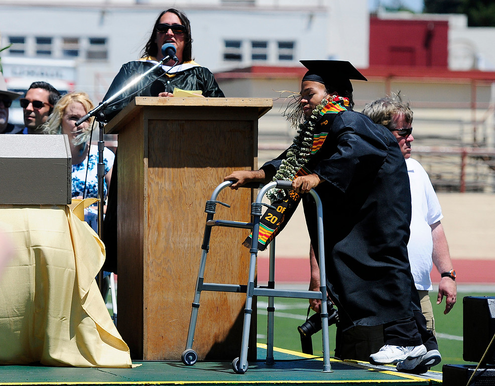 . VALLEJO, CA - JUNE 8, Kian Rose makes his way across the stage to receive his diploma during the Jesse Bethel High School graduation on Friday. (CHRIS RILEY/TIMES-HERALD)