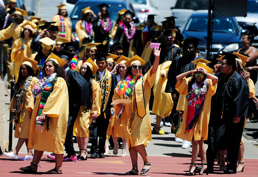 . VALLEJO, CA - JUNE 8, Graduate walk on to Corbus Field during the Jesse Bethel High School graduation on Friday. (CHRIS RILEY/TIMES-HERALD)