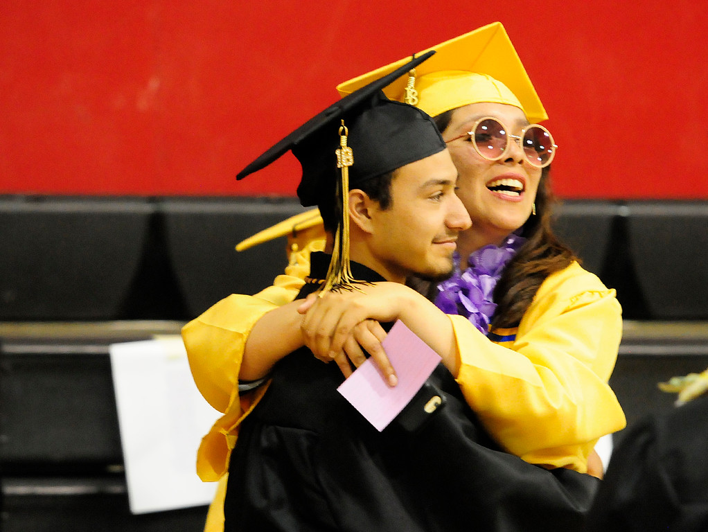 . VALLEJO, CA - JUNE 8, Jose Cossyleon gets a hug from Isabel Chavez before the Jesse Bethel High School graduation on Friday. (CHRIS RILEY/TIMES-HERALD)