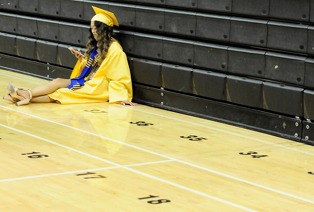 . VALLEJO, CA - JUNE 8, Kaelin Pasibe takes a moment to rest before graduating from Jesse Bethel High School on Friday. (CHRIS RILEY/TIMES-HERALD)