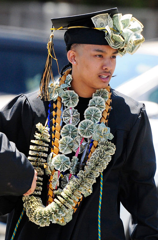 . VALLEJO, CA - JUNE 8, A graduate enters the Bottari Gym sporting money fashion before the Jesse Bethel High School graduation on Friday. (CHRIS RILEY/TIMES-HERALD)