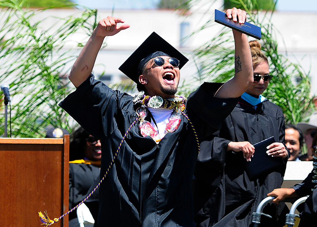 . VALLEJO, CA - JUNE 8, Marlo Aniciete celebrates as he walks the stage during the Jesse Bethel High School graduation on Friday. (CHRIS RILEY/TIMES-HERALD)
