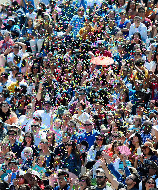 . VALLEJO, CA - JUNE 8, Confetti floats through the air as friends and family cheer for their graduates during the Jesse Bethel High School graduation on Friday. (CHRIS RILEY/TIMES-HERALD)