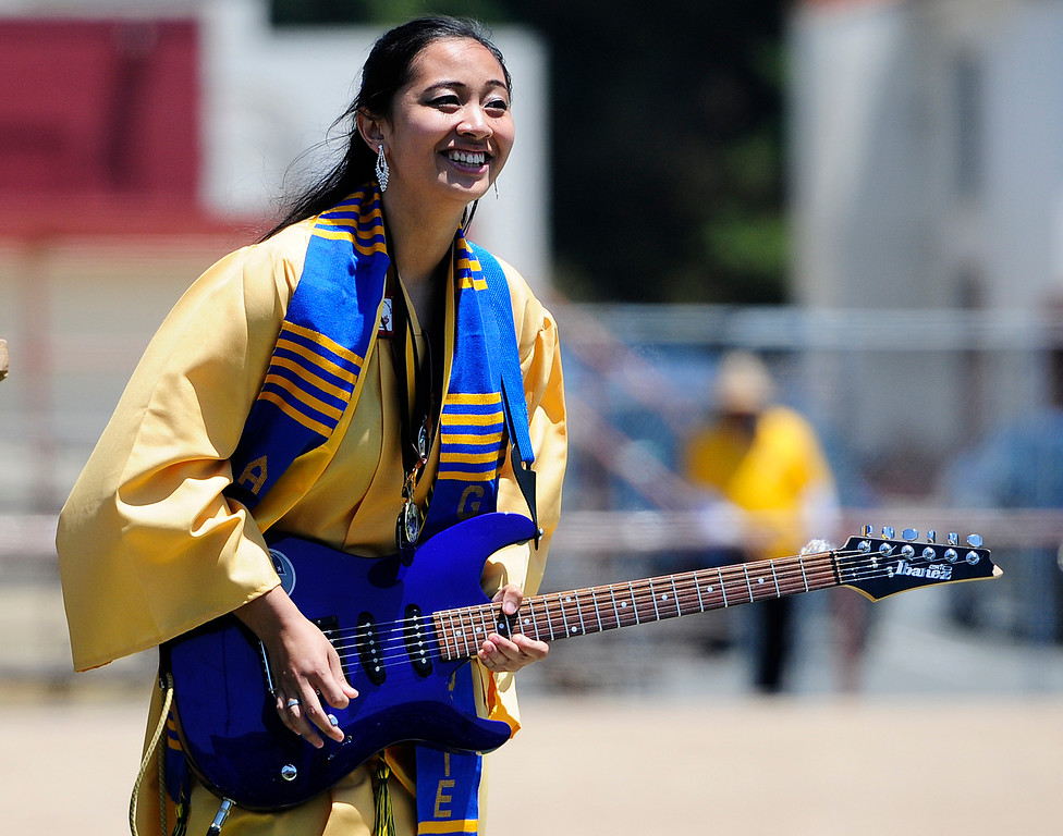 . VALLEJO, CA - JUNE 8, Ruvianne Mercado plays the national antehm on an electric guitar during the Jesse Bethel High School graduation on Friday. (CHRIS RILEY/TIMES-HERALD)