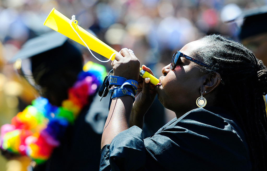 . VALLEJO, CA - JUNE 8, Biomed Academy advisor Odessa Matthis-Montgomery blows a horn of each of her students as they get their diplomas during the Jesse Bethel High School graduation on Friday. (CHRIS RILEY/TIMES-HERALD)