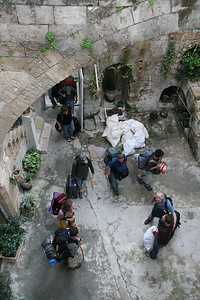Guests checking into the Fauzi Azar Inn, an ancient Arab Mansion turned hostel in the Old City of Nazareth