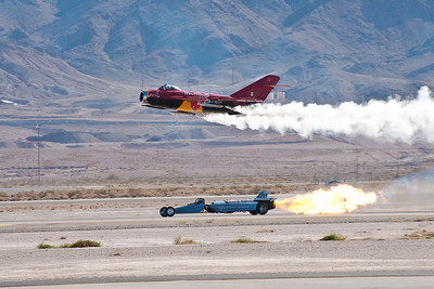 MiG-17 (sponsored by Red Bull) and the Air Force's jet car in a race. When the MiG crossed the starting line, the jet car lit its engine and beat the MiG to the finish line just ahead.
