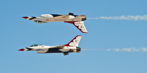 USAF Thunderbirds flying F-16s. Much more photogenic than the Blue Angels, the Navy's counterpart demonstration team.