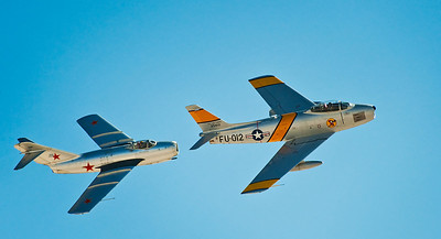 Korean War vintage MiG-15 (left) and F-86 Sabre (right.) This isn't photoshop. During the show these two magnificent aircraft flew together. A real treat!  The F-86 entered service in May 1948. During its life time, it set a world speed record of almost 671 mph. During the Korean War, the F-86's shot down 792 MiGs losing only 76 Sabres ... a kill ratio of 10-1.