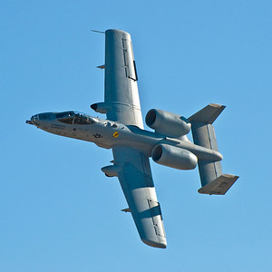 A-10 Thunderbolt II. This is known as the Tank-Buster. It is a relatively slow but very maneuverable weapons platform. It can dive on a target, release its weapons, climb and turn for the next dive in less than 30 seconds. Two Warthogs working together give an enemy on the ground essentially no time to switch from defense to offense. And with a gattling-style machine gun in the nose and missiles on the wings ... a tank stands no chance of survival. The plane is armored with titanium, and has redundant primary structural components to survive in its close air support.