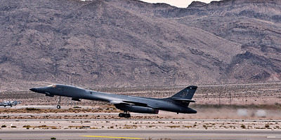B-1 Lancer. This is the Air Force's super sonic, variable-sweep wing, strategic bomber meant to replace the B-52 The faster B-1A was prototyped in the 70's and canceled. The B-1B was built beginning in the 80's and has seen action from 1998 in Operation Desert Fox, and in Kosovo, Afghanistan and Iraq. It is a stealthy mach 1.25 aircraft.
