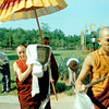 WM-84-19 Ven Gyatrul Rinpoche carries kapala into temple, by Wib Middleton