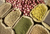 Various herbs, grains and vegetables in Indian market, by Mannie Garcia